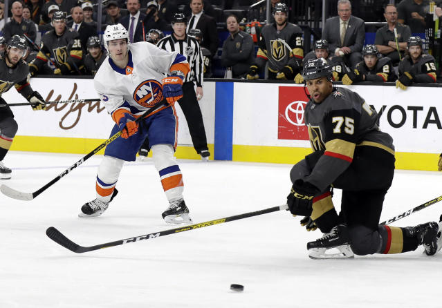 New York Islanders forward Mathew Barzal (13) watches his shot as Vegas Golden Knights right wing Ryan Reaves (75) defends during the third period of an NHL hockey game Saturday, Feb. 15, 2020, in Las Vegas. The Golden Knights won 1-0. (AP Photo/Isaac Brekken)