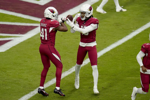 Arizona Cardinals wide receiver DeAndre Hopkins (10) celebrates his touchdown with teammate running back Kenyan Drake (41) during the first half of an NFL football game against the Washington Football Team, Sunday, Sept. 20, 2020, in Glendale, Ariz. (AP Photo/Ross D. Franklin)