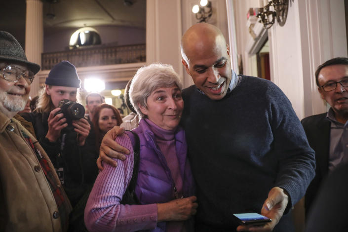 CORRECTS TO SATURDAY, NOT SUNDAY-U.S. Sen. Cory Booker, D-N.J., prepares to take a selfie with a supporter at a post-midterm election victory celebration in Manchester, N.H., on Saturday, Dec. 8, 2018. (AP Photo/Cheryl Senter)