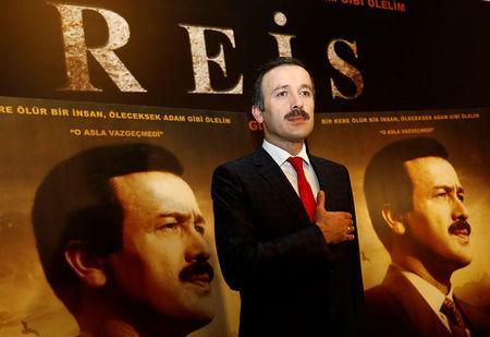 """Actor Reha Beyoglu, who portrays Turkish President Erdogan in a biopic titled """"Reis"""", or """"Chief"""", poses for photographers during a gala screening of the movie in Istanbul"""