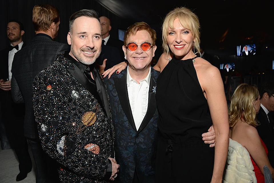 <p>(L-R) Hosts David Furnish and Elton John, and actress Toni Collette attends the 25th Annual Elton John AIDS Foundation's Academy Awards Viewing Party at The City of West Hollywood Park on February 26, 2017 in West Hollywood, California. (Photo by Michael Kovac/Getty Images for EJAF) </p>