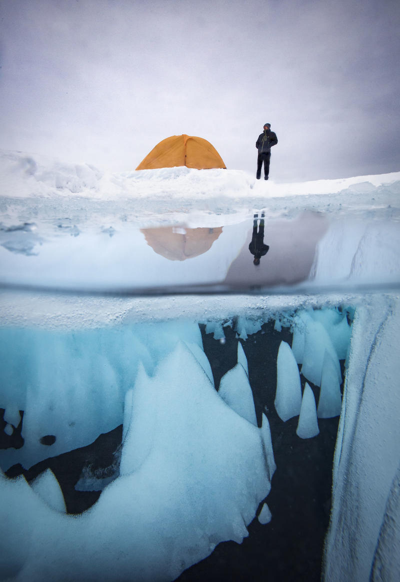 Underwater view of Greenland icecap. (Photo: Paul Zizka/Caters News)