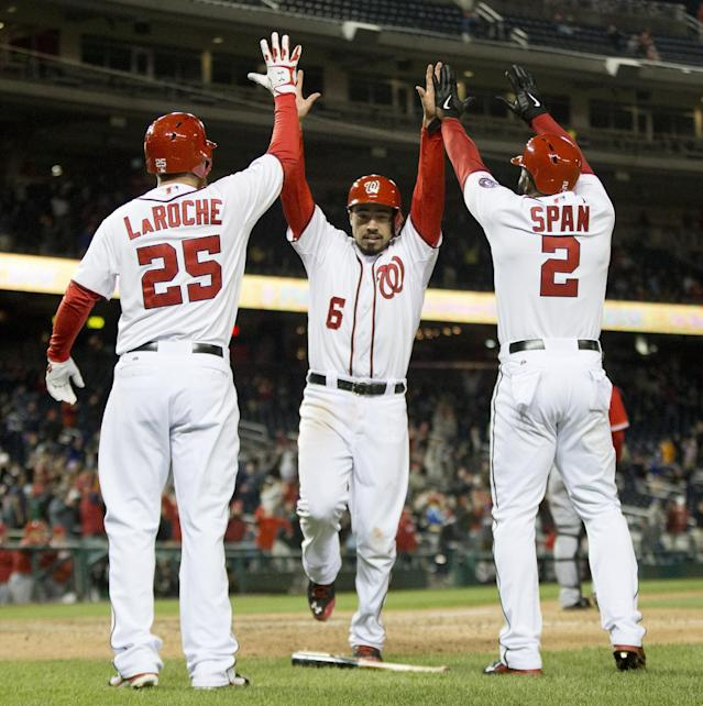 Washington Nationals' Anthony Rendon (6) celebrates with teammates Denard Span (2) and Adam LaRoche (25) after scoring the tying run on a double by Jayson Werth in the ninth inning of a baseball game against the Los Angeles Angeles, Wednesday, April 23, 2014 in Washington. The Nationals won 5-4. (AP Photo/Pablo Martinez Monsivais)