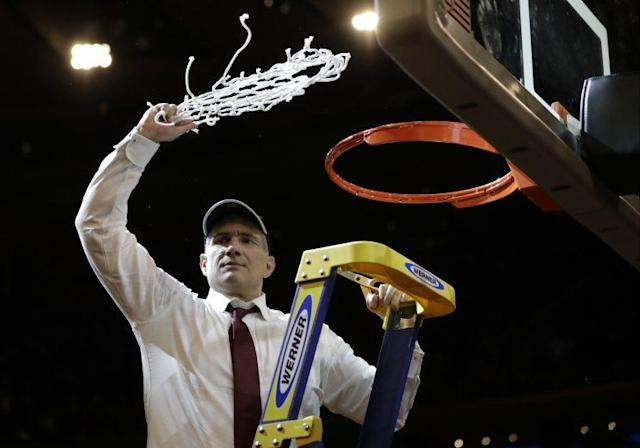 South Carolina head coach Frank Martin swings the net around after cutting it down after beating Florida 77-70 in the East Regional championship game of the NCAA men's college basketball tournament, Sunday, March 26, 2017, in New York. (AP Photo/Julio Cortez)