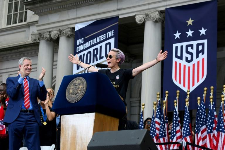 USA women's captain Megan Rapinoe celebrated with New York Mayor Mayor Bill de Blasio after the ticker tape parade for the women's World Cup team