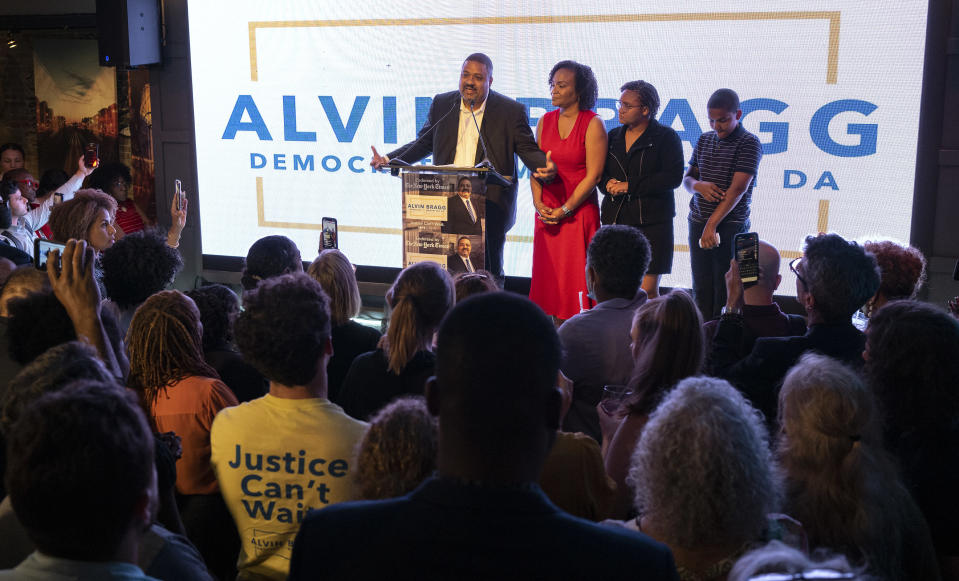 Alvin Bragg, a former top deputy to New York's attorney general, stands with his family as he speaks to supporters in New York, late Tuesday, June 22, 2021. The former top deputy to New York's attorney general, was poised to become Manhattan's first Black district attorney and to take over the investigation of former President Donald Trump after his closest opponent conceded in the the Democratic primary.(AP Photo/Craig Ruttle)
