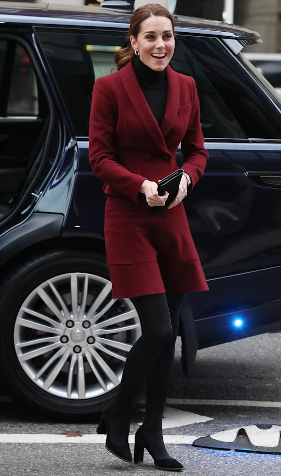 <p>For an unannounced trip to UCL on November 21, the Duchess of Cambridge recycled a Paule Ka skirt suit which she was first spotted wearing back in 2012. She finished the berry-hued ensemble with a black turtleneck, £335 Tod's suede block heels (which have since sold out), £5,000 Asprey Oak Leaf earrings and her go-to Mulberry clutch. <em>[Photo: Getty]</em> </p>