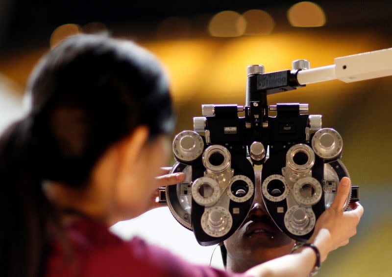 FILE PHOTO: A patient undergoes an eye exam at the Remote Area Medical health clinic in Inglewood