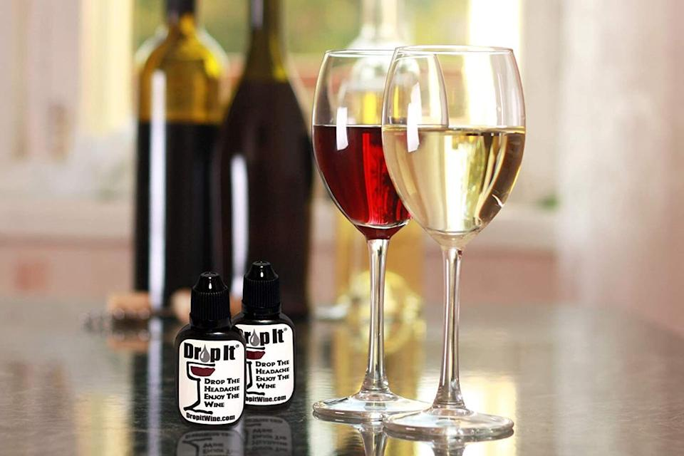 """A natural wine sulfate and tannin remover, this little bottle works its magic on your glass in just a few seconds. It's designed to help ease those infamous post-wine headaches or reactions. It's also a lot more cost-effective and environmentally friendly than wine wands or other competitors — a single bottle of this can be used to treat up to 55 glasses of wine, as opposed to wands that can only do a few glasses each before they get tossed.<br /><br />Drop It recommends<strong>1-2 drops for each glass of white wine, 2-3 for a glass of red, and 7-9 if you're treating the whole bottle at once</strong>. Once it's in the glass, swirl lightly for 20 seconds.<br /><br /><strong>Promising review:</strong>""""I have an allergy to sulfites so if I consume a glass or two of wine I break out in a skin rash. My skin becomes red, itchy and I scratch. Usually, the areas that affect me are my back and arms. If I scratch a lot it tends to bleed. If I refrain from wine, then of course I don't break out.<strong>I enjoy wine and I've tried everything and nothing seems to work or even come close except for Drop It! I have to say it helps!</strong>I squeeze 2-3 drops in my glass of wine, stir it around for at least 20 sec. and enjoy a glass of wine.<strong>I notice I don't break out and If I do, it's minimal. I would recommend it for anyone having any type of allergies.</strong>My skin is better, my nose is not congested and my throat does not itch. Thank you Drop It!"""" —<a href=""""https://www.amazon.com/gp/customer-reviews/RIA049ZBZRB1N?ascsubtag=5738624%2C14%2C35%2Cd%2C0%2C0%2C0%2C962%3A1%3B901%3A2%3B900%3A2%3B974%3A2%3B975%3A2%3B982%3A2%3B994%3A1%2C0%2C0&linkCode=ll2&tag=huffpost-bfsyndication-20&linkId=9cfa9151509edb4a40f0b94a23aff791&language=en_US&ref_=as_li_ss_tl"""" target=""""_blank"""" rel=""""nofollow noopener noreferrer"""" data-skimlinks-tracking=""""5738624"""" data-vars-affiliate=""""Amazon"""" data-vars-href=""""https://www.amazon.com/gp/customer-reviews/RIA049ZBZRB1N?tag=bfemmalord-20&ascsubtag=5738624%2"""