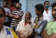A woman whose house was damaged cries after a three-story dilapidated building collapsed following heavy monsoon rains n Mumbai, India, Thursday, June 10, 2021. (AP Photo/Rafiq Maqbool)