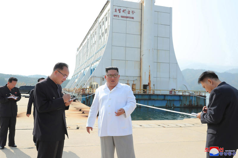 """FILE - In this undated file photo provided on Wednesday, Oct. 23, 2019, by the North Korean government, North Korean leader Kim Jong Un, center, visits the Diamond Mountain resort in Kumgang, North Korea. North Korea on Friday, Nov. 15, 2019, said it issued an ultimatum to South Korea that it will tear down South Korean-made hotels and other facilities at the North's Diamond Mountain resort if the South continues to ignore its demands to come and clear them out.  Korean language watermark on image as provided by source reads """"KCNA"""" which is the abbreviation for Korean Central News Agency. (Korean Central News Agency/Korea News Service via AP, File)"""