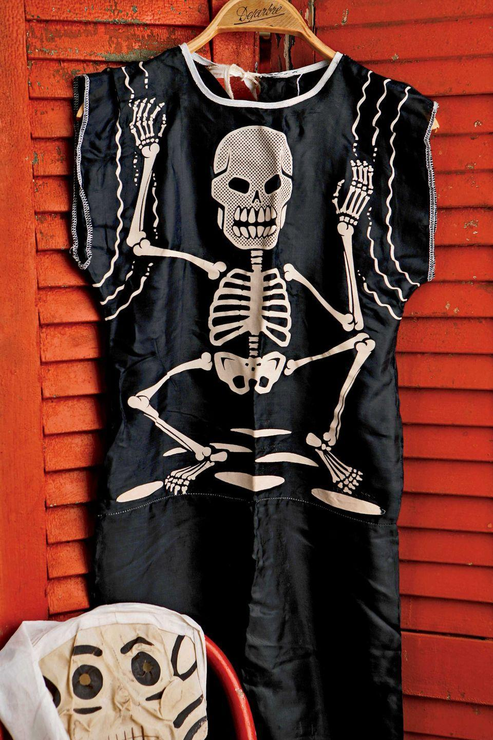 <p>Beginning in the 1940s, manufacturers such as such as Ben Cooper Inc. began making costumes and selling them through Sears, JC Penney, Woolworths, and local five-and-tens for as little as $1.25. This skeleton outfit and hooded muslin mask is from the early 1950s.</p>