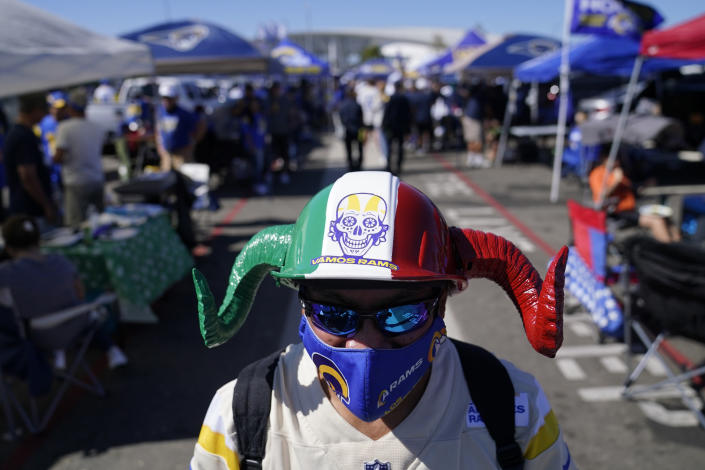 A fan of the Los Angeles Rams tailgates before an NFL football game against the Chicago Bears at SoFi Stadium Sunday, Sept. 12, 2021, in Inglewood, Calif. (AP Photo/Jae C. Hong)