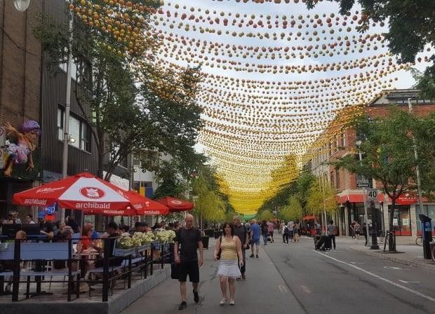 A stretch of Ste-Catherine Street East is closed each summer and many businesses convert their sidewalk spaces into patios.