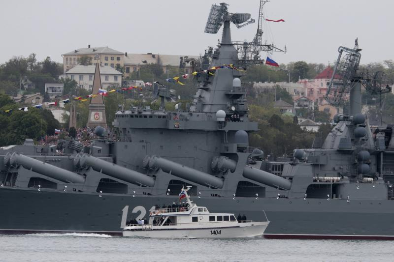 Russian President Vladimir Putin, on a boat, inspects the missile cruiser Moskva during a navy parade marking the Victory Day in Sevastopol, Crimea, Friday, May 9, 2014. Putin extolled the return of Crimea to Russia before tens of thousands Friday during his first trip to Black Sea peninsula since its annexation. The triumphant visit was quickly condemned by Ukraine and NATO. (AP Photo / Ivan Sekretarev)