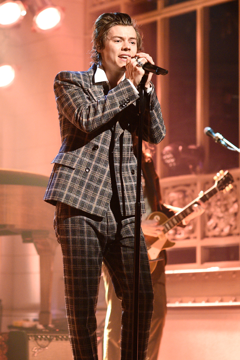 <p>For his solo debut on <em>Saturday Night Live</em>, Harry wore — what else? — Gucci. Be honest: You've seen this performance at least 3,000 times by now. No shame, necessary!</p>