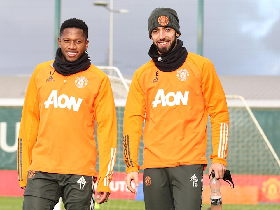 Fernandes (right) in training with FredManchester United via Getty Images