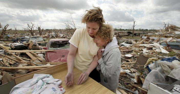 Beverly Winans hugs her daughter Debbie Spurlin while salvaging items from Winans' devastated home in Joplin, Mo. Wednesday, May 25, 2011. Winans and her husband rode out the EF-5 tornado by hiding under a bed in the home. The tornado tore through much of the city Sunday, damaging a hospital and hundreds of homes and businesses and killing at least 123 people.