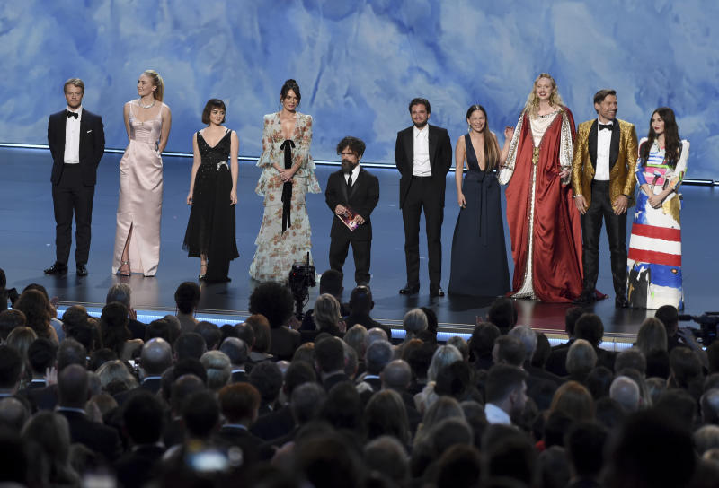 """The cast of """"Game of Thrones"""" appear on stage to present the award for outstanding supporting actress in a limited series or movie at the 71st Primetime Emmy Awards on Sunday, Sept. 22, 2019, at the Microsoft Theater in Los Angeles. From left are, Alfie Allen, Sophie Turner, Maisie Williams,Lena Headey, Peter Dinklage, Kit Harington Emilia Clarke, Gwendoline Christie, Nikolaj Coster-Waldau and Carice van Houten. (Photo by Chris Pizzello/Invision/AP)"""