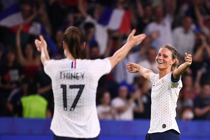 Gaetane Thiney goes to celebrate with Amandine Henry after the latter's goal gave hosts France victory over Brazil at the women's World Cup on Sunday (AFP Photo/FRANCK FIFE)