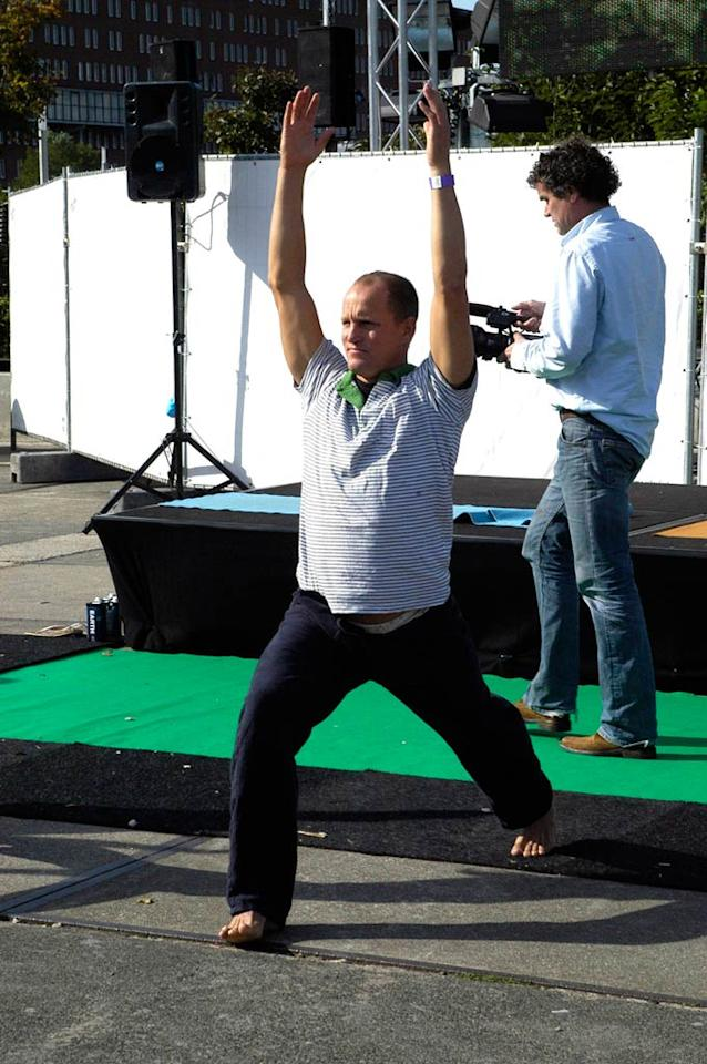 "Woody preps for this weekend's NFL playoffs with a standard yoga pose. ""Touchdown!"" <a href=""http://www.x17online.com"" target=""new"">X17 Online</a> - September 28, 2007"