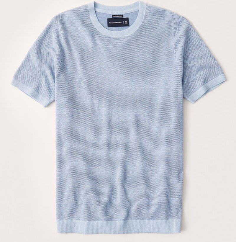 """<p><strong>Abercrombie & Fitch</strong></p><p>abercrombie.com</p><p><strong>$29.75</strong></p><p><a href=""""https://go.redirectingat.com?id=74968X1596630&url=https%3A%2F%2Fwww.abercrombie.com%2Fshop%2Fus%2Fp%2Fshort-sleeve-sweater-tee-40165319%3FcategoryId%3D12202%26seq%3D03%26faceout%3Dprod1&sref=https%3A%2F%2Fwww.esquire.com%2Fstyle%2Fmens-fashion%2Fg32631767%2Fsummer-mens-fashion-memorial-day-sale%2F"""" rel=""""nofollow noopener"""" target=""""_blank"""" data-ylk=""""slk:Buy"""" class=""""link rapid-noclick-resp"""">Buy</a></p><p>A short-sleeve...sweater?! Say less. </p>"""