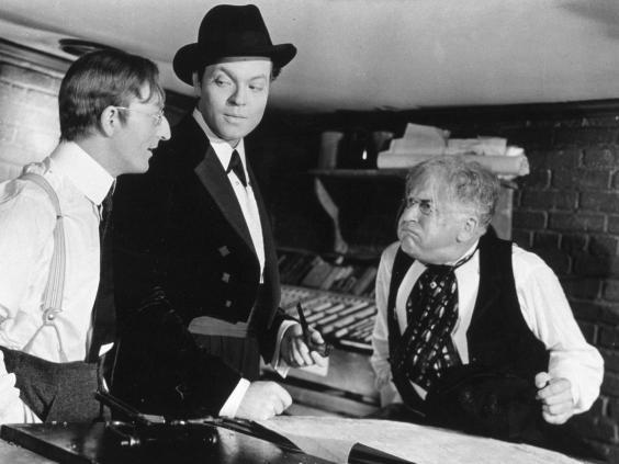 Orson Welles, centre, in 'Citizen Kane' (Rex)