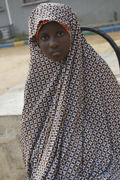 FILE - This Dec. 24, 2014 file photo, shows Zahra'u Babangida, a 13 year-old girl arrested with explosives strapped to her body in Kano Nigeria. Radical Islamic militants from Boko Haram are increasingly forcing children to carry out bombings, with the number of attacks since January already nearly reaching the total for all of last year, according to a report released Wednesday, April 12, 2017 by the U.N. children's agency. (AP Photo/File)