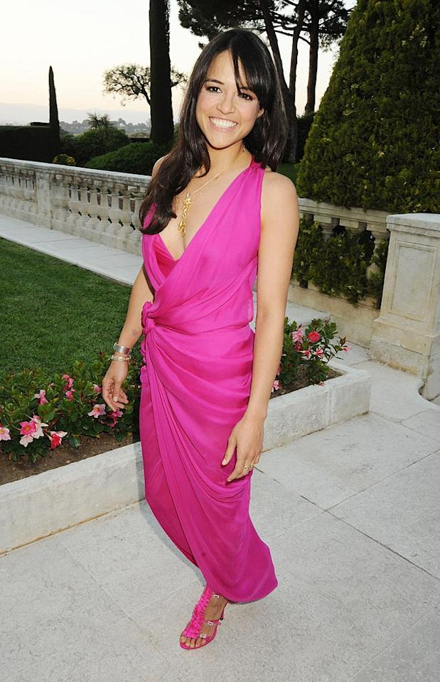 """Michelle Rodriguez looked relaxed and happy in a hot pink, sarong-style frock. And why shouldn't she be? She's in Cannes! Dave M. Benett/<a href=""""http://www.gettyimages.com/"""" target=""""new"""">GettyImages.com</a> - May 20, 2010"""