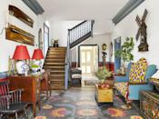 """<p>This parlor in a<a href=""""https://www.veranda.com/home-decorators/a28577724/tony-baratta-williamsburg-home-tour/"""" rel=""""nofollow noopener"""" target=""""_blank"""" data-ylk=""""slk:Colonial Williamsburg home designed by Anthony Baratta"""" class=""""link rapid-noclick-resp""""> Colonial Williamsburg home designed by Anthony Baratta</a> may not have painted stairs, but a painted bannister is the next best thing. For those who are afraid of playing too much with color or simply love their wood floors, they can follow the direction of the brilliant designer. Baratta uses the same gray-blue paint color throughout the home on the trim, fireplace mantle, and elsewhere to bring unity throughout.</p>"""