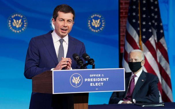PHOTO: Former Democratic presidential candidate Pete Buttigieg speaks as U.S. President-elect Joe Biden looks at Biden's transition headquarters on Dec. 16, 2020, in Wilmington, Del. (Kevin Lamarque/Pool via Getty Images, FILE)