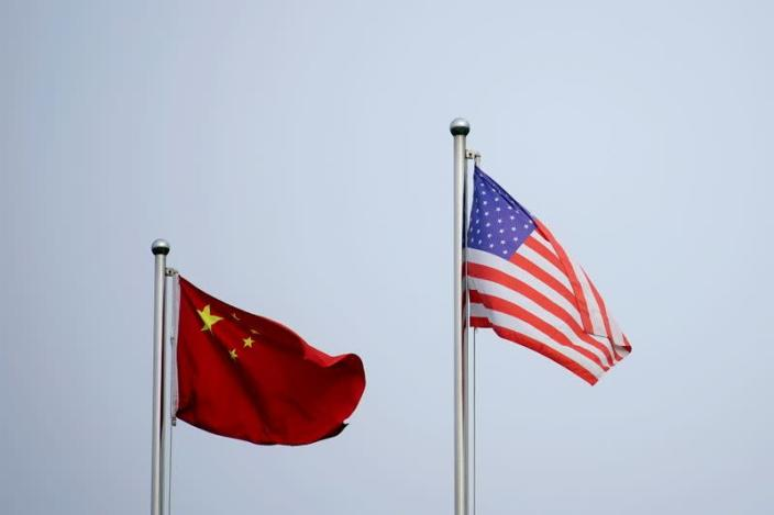 FILE PHOTO: Chinese and U.S. flags flutter outside a company building in Shanghai