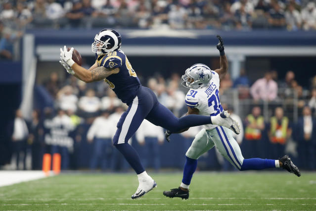 <p>Los Angeles Rams tight end Tyler Higbee (89) catches a pass against Dallas Cowboys safety Byron Jones (31) in the second quarter at AT&T Stadium. Mandatory Credit: Tim Heitman-USA TODAY Sports </p>