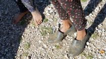 Children in a shepherding family are seen bare foot or wearing ill-fitting shoes near Ain el-Louh in Morocco's Middle Atlas mountains