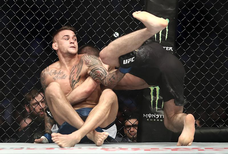 ABU DHABI, UNITED ARAB EMIRATES SEPTEMBER 7, 2019: UFC lightweight champion Khabib Nurmagomedov and interim UFC lightweight champion Dustin Poirier fight in their title unification bout at the UFC 242 mixed martial arts tournament. Valery Sharifulin/TASS (Photo by Valery Sharifulin\TASS via Getty Images)