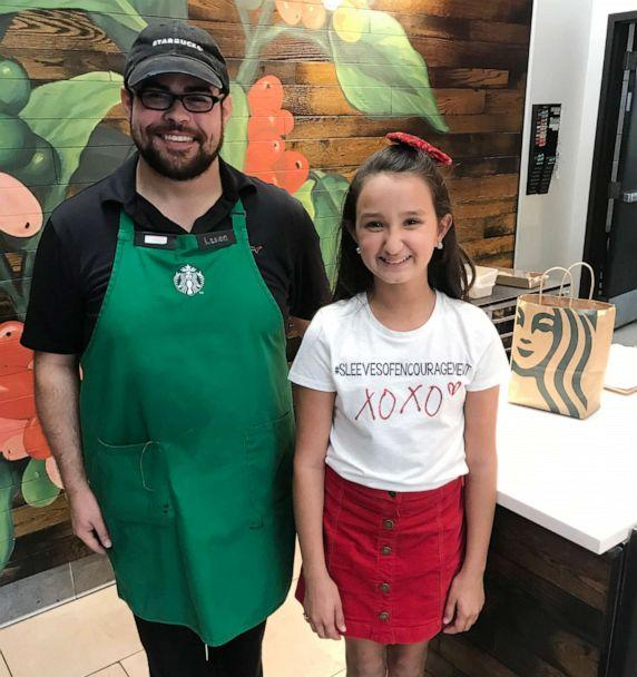 PHOTO: Nine-year-old Ayvah Doyle from Port Neches, Texas, is pictured with a Starbucks employee. (Courtesy Kaycee Doyle)