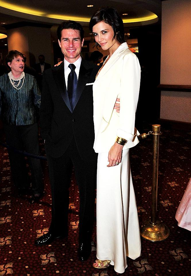 """Katie Holmes donned ivory separates from her very own Holmes-Yang collection, while hubby Tom Cruise looked dapper in a dark suit. Brandon Todd/<a href=""""http://www.splashnewsonline.com"""" target=""""new"""">Splash News</a> - May 9, 2009"""