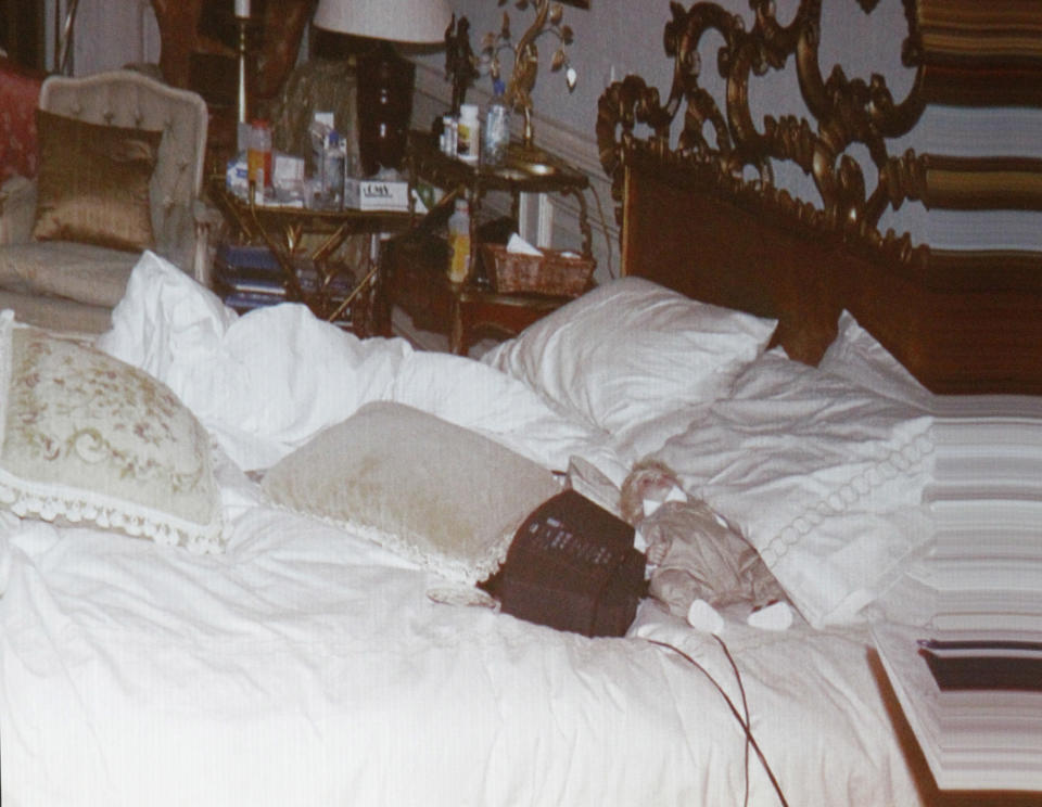 The doll on Michael Jackson bed in a crime scene photo shown during Conrad Murray's involuntary manslaughter trial in 2011. (Photo: Al Seib-Pool/Getty Images)