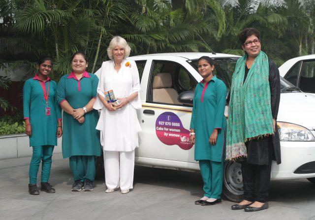 Camilla with Meenu Vadhera, right, executive director of the Azard Foundation, and taxi drivers from Women on Wheels