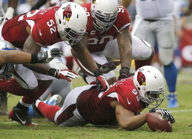 Arizona Cardinals defensive end Calais Campbell (93) recovers a fumble as teammates Jasper Brinkley (52) and Darnell Dockett (90) pursue against the Detroit Lions during the second half of a NFL football game, Sunday, Sept. 15, 2013, in Glendale, Ariz. (AP Photo/Matt York)
