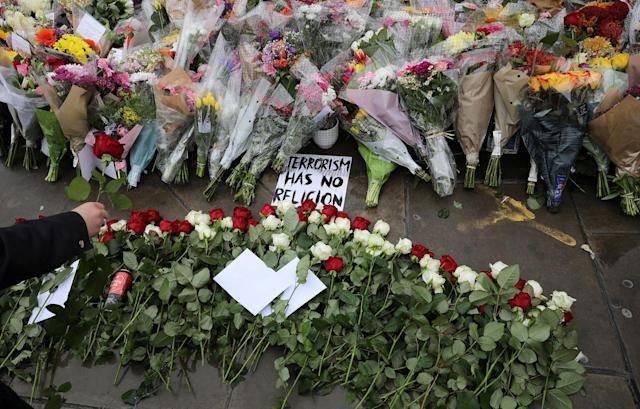 <p>A rose is laid among floral tributes for the victims of the attack on London Bridge and Borough Market at London Bridge, London, Britain June 6, 2017. (Photo: Marko Djurica/Reuters) </p>