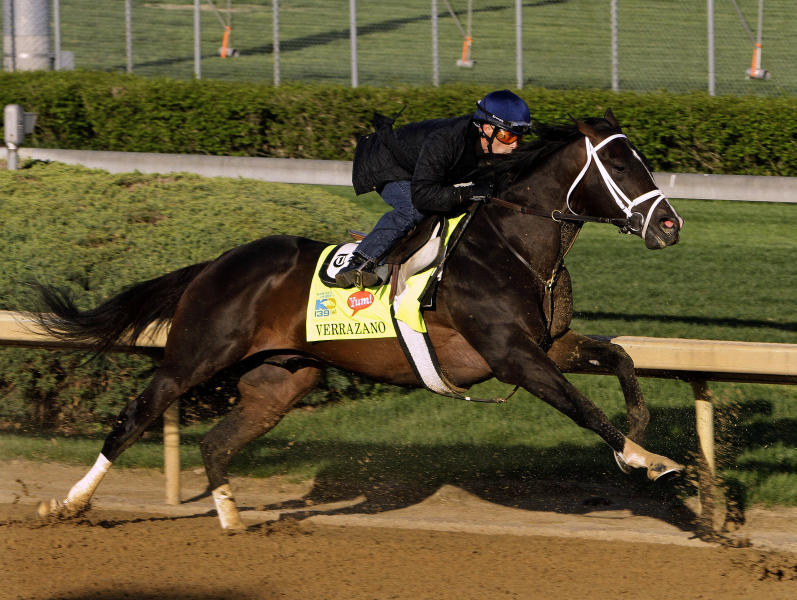 Kentucky Derby hopeful Verrazano, with jockey Gary Stevens aboard, stretches out in the turn during a morning workout at Churchill Downs in Louisville, Ky., Sunday, April 21, 2013. (AP Photo/Garry Jones)