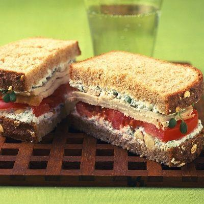 """<p>A homemade cheese spread with fresh herbs turns a sandwich of roast turkey on whole wheat into something special.</p><p>Get the recipe from <a href=""""https://www.delish.com/cooking/recipe-ideas/recipes/a20014/turkey-sandwich-herbed-farmer-cheese-sprouts-tomato-recipe-mslo1112/"""" rel=""""nofollow noopener"""" target=""""_blank"""" data-ylk=""""slk:Delish"""" class=""""link rapid-noclick-resp"""">Delish</a>.</p>"""