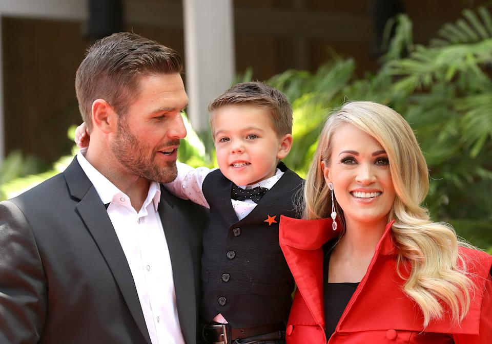 HOLLYWOOD, CA - SEPTEMBER 20:  Carrie Underwood with her husband, Mike Fisher and their son, Isaiah Michael Fisher attend the ceremony honoring Carrie Underwood with a Star on The Hollywood Walk of Fame held on September 20, 2018 in Hollywood, California.  (Photo by Michael Tran/FilmMagic,)