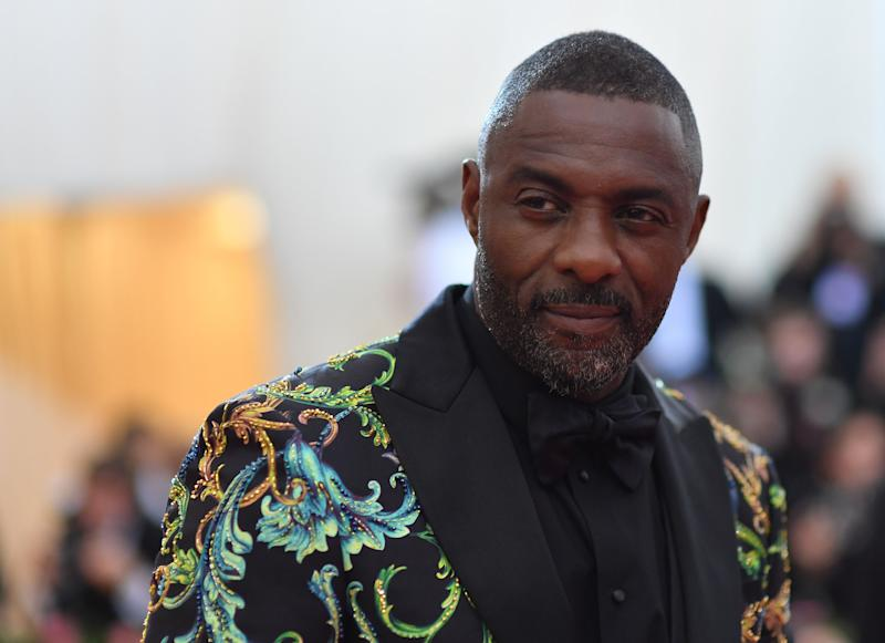 "English actor Idris Elba arrives for the 2019 Met Gala at the Metropolitan Museum of Art on May 6, 2019, in New York. - The Gala raises money for the Metropolitan Museum of Arts Costume Institute. The Gala's 2019 theme is Camp: Notes on Fashion"" inspired by Susan Sontag's 1964 essay ""Notes on Camp"". (Photo by ANGELA WEISS / AFP) (Photo credit should read ANGELA WEISS/AFP/Getty Images)"