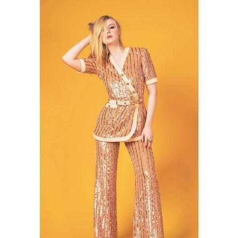 """<p>Elle Fanning shone in a sequinned striped two-piece by Alessandro Michele for Gucci. </p><p><a href=""""https://www.instagram.com/p/CNQ19fClUC1/?utm_source=ig_embed&utm_campaign=loading"""" rel=""""nofollow noopener"""" target=""""_blank"""" data-ylk=""""slk:See the original post on Instagram"""" class=""""link rapid-noclick-resp"""">See the original post on Instagram</a></p>"""