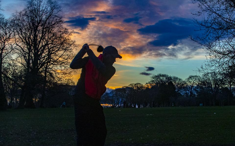 A golfer tees off at Allerton Manor Golf Club in Liverpool on the first day of a major easing of England's coronavirus lockdown to allow far greater freedom outdoors. Picture date: Monday March 29, 2021.