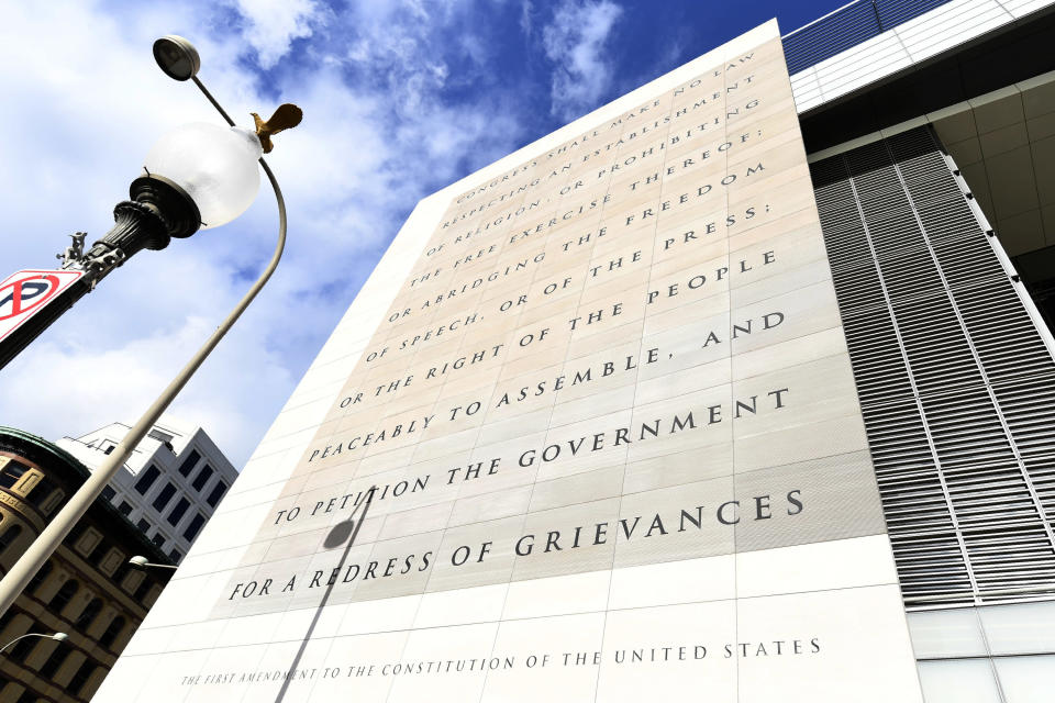 FILE—This file photo from Dec. 31, 2019 shows the facade bearing the First Amendment of the U.S. Constitution on the front of the Newseum, a private museum dedicated to exploring modern history as told through the eyes of journalists, on the last day it was open in Washington. The façade will be reinstalled at The National Constitution Center in Philadelphia. (AP Photo/Susan Walsh, File)