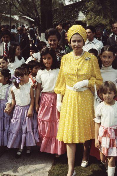 <p>On a 1975 trip to Mexico, the Queen dressed up in all-over yellow. </p>