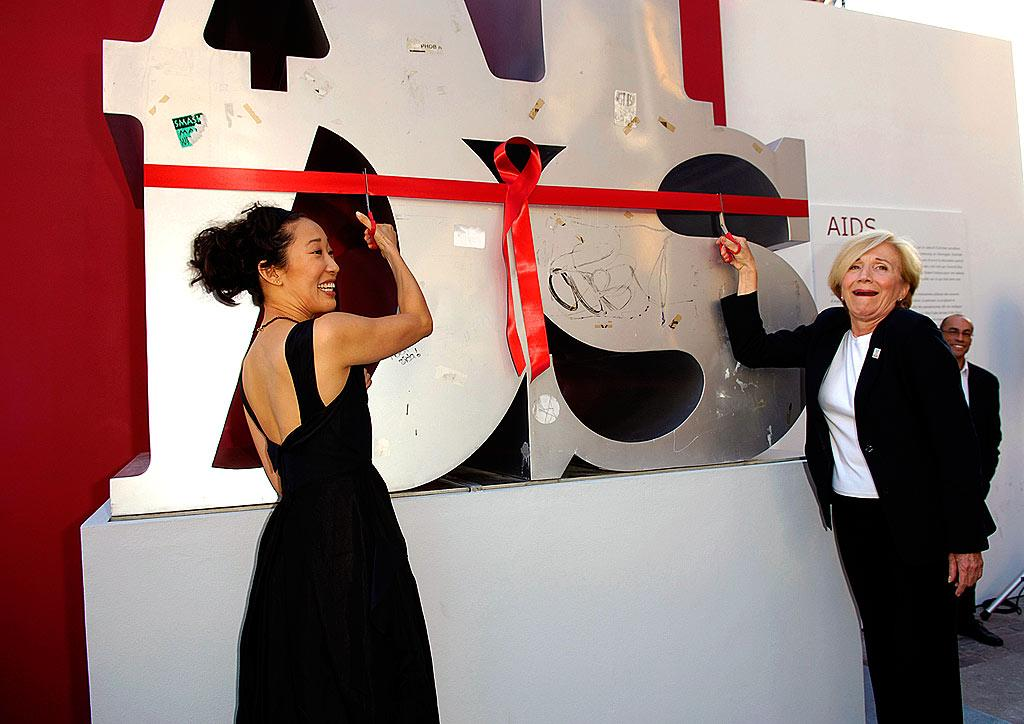 "Actresses Sandra Oh and Olympia Dukakis unveil the AIDS Sculpture at the Royal Ontario Museum Toronto. The piece, which travels worldwide, was inspired by Robert Indiana's infamous LOVE sculpture. George Pimentel/<a href=""http://www.wireimage.com"" target=""new"">WireImage.com</a> - August 12, 2006"